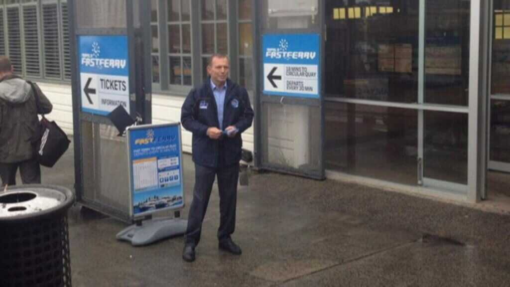 Abbott posts photo of himself greeting commuters at Manly Wharf