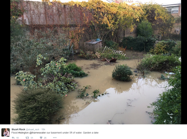 Stuart Rock's backgarden in ruins after burst water mains flooded Islington, north London.