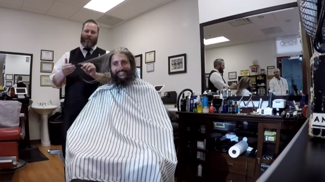 """Off comes the beard and long hair, in a mission to look """"business-like"""". Source: YouTube"""