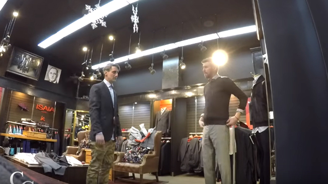 Alex can't believe he's getting fitted for a $5,000 suit, the day before the job interview. Source: YouTube