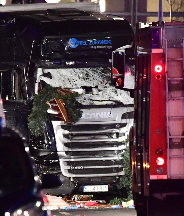 The 18-wheel black Scania, laden with steel cargo, tore through stalls and shoppers on Breitscheidplatz Square