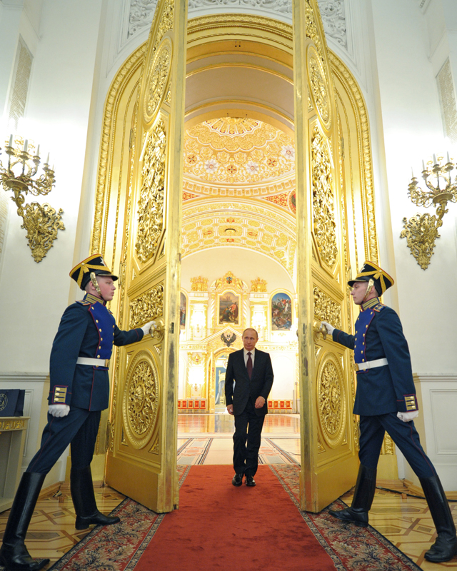 Russia's President Vladimir Putin arrives for a meeting with the newly promoted top officers from various branches of the Russian armed forces at the Kremlin in Moscow Source: AFP