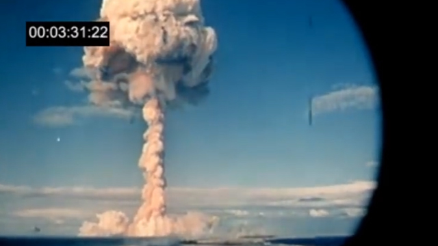 A French nuclear test detonates in the Pacific. (YouTube).