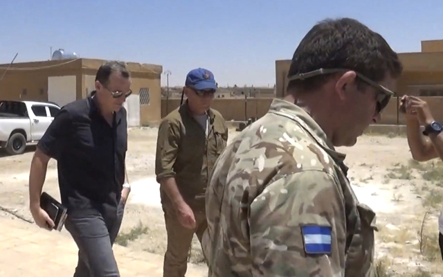 Brett McGurk (left), top US envoy for the international coalition combatting Islamic State, during a visit with local military leaders in Syria. Photo: AAP