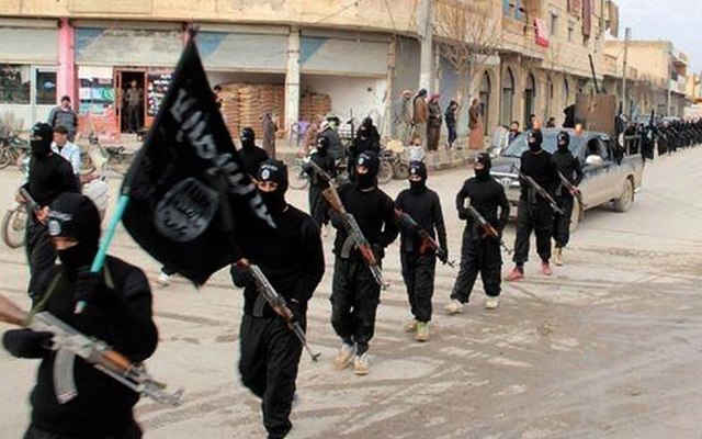 2014 photo of Islamic State fighters marching in Raqqa, Syria. Photo: AAP