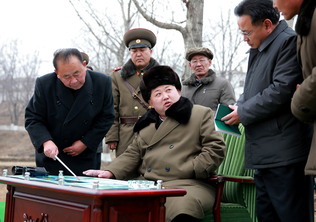 Undated picture released from North Korea's official Korean Central News Agency on March 15, 2016 shows North Korean leader Kim Jong-Un being briefed by advisors. (AFP PHOTO/KCNA VIA KNS)