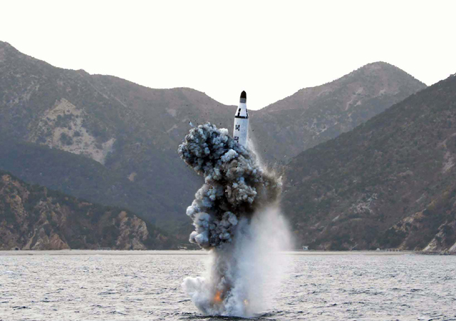 An underwater test-fire of a strategic submarine ballistic missile at an undisclosed location in North Korea on April 23, 2016. (AFP PHOTO/KCNA VIA KNS)