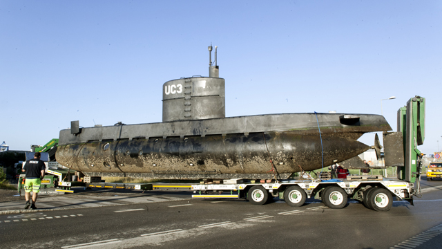 The privately owned submarine, Nautilus, which is the suspected crime scene for the assumed murder on Swedish journalist Kim Wall, is carried out of Copenhagen harbor on a truck for further forensic police investigation. (Getty)