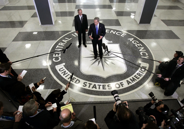 Then US President George W Bush speaks to reporters with then CIA Director Porter Goss at the headquarters of the Central Intelligence Agency 03 March, 2005 in Langley, Virginia.