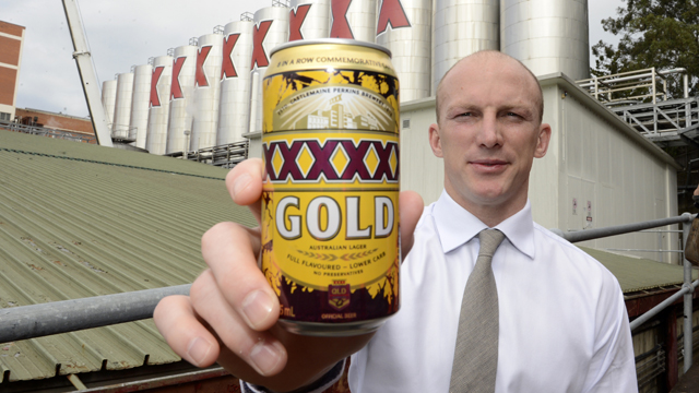 Queensland Rugby League legend Darren Lockyer poses with a can of a special edition XXXX beer at their Milton brewery in Brisbane, 2013