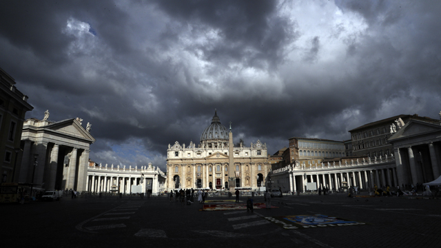 Clouds hang over St. Peter's Basilica, at the Vatican
