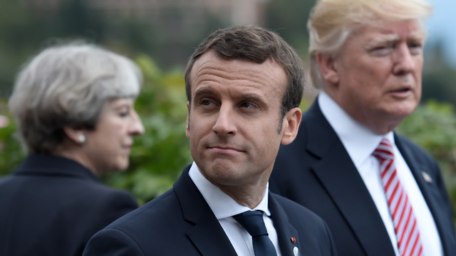 Britain's Prime Minister Theresa May, French President Emmanuel Macron and US President Donald Trump attend the Summit of the Heads of State and of Government of the G7