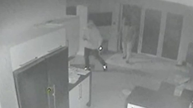 CCTV shows the men slide in through a back door at Dr Waheed's Ealing home. Source: Supplied.