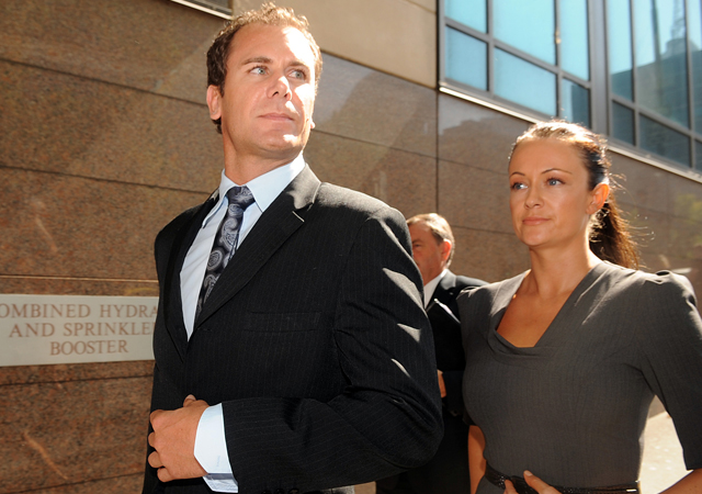 Former AFL star Wayne Carey leaves the Melbourne Magistrate's court with his partner Kate Neilson in 2009. Carey was fined $2,000 after he pleaded guilty to assaulting police at his Port Melbourne home. Source: AAP