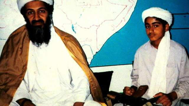 Osama bin Laden, now dead, sits with his young son Hamza, date unknown. Source: 60 Minutes