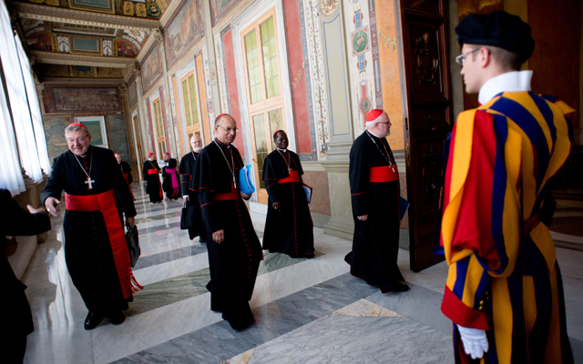 2013 photo shows Cardinals George Pell (L), Oswald Gracias, Laurent Monsengwo Pasinya and Reinhard Marx before their meeting with Pope Francis.