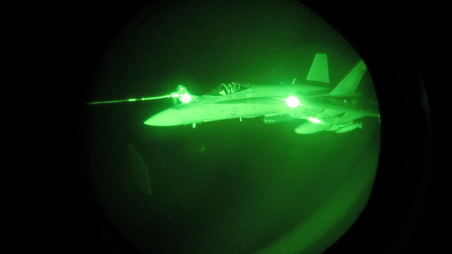 Night Vision image of an Australian F/A-18A Hornet refuelling from a Royal Australian Air Force KC-30A Multi Role Tanker Transport aircraft during a mission over Syria.