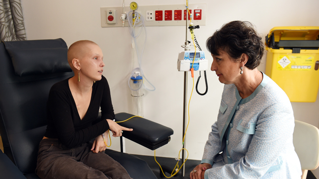 Cancer sufferer Matilda Kubany-Dean, 21, speaks to NSW Minister for Medical Research Pru Goward at Royal Prince Alfred Hospital in Sydney, December, 2016. Doctors are recruiting cancer patients in a world-first cannabis trial in NSW for the prevention of chemotherapy induced nausea and vomiting.