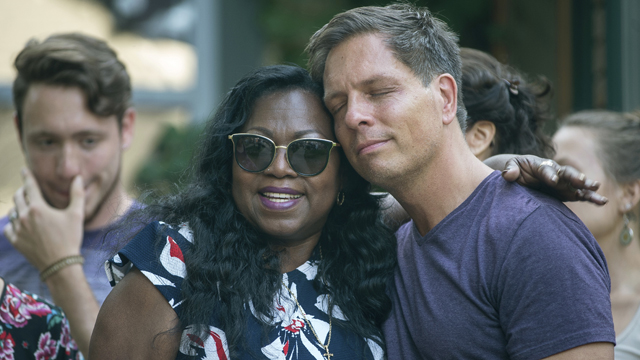 Don Damond, the fiance of Justine Damond, is comforted outside his home by Valerie Castile, the mother of Philando Castile