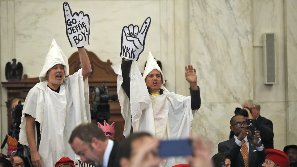 Protesters dressed as KKK disrupt confirmation hearing for new US attorney general