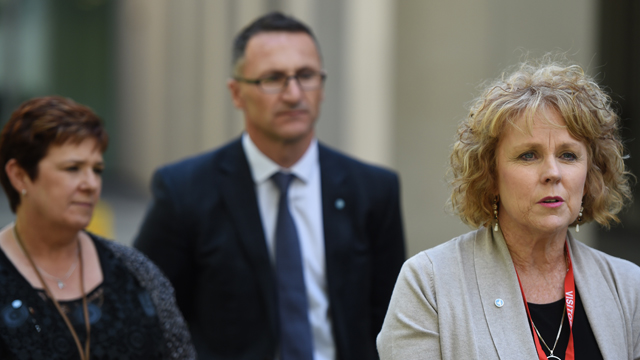 Medicinal cannabis campaigner Lucy Haslam (right) speaking at at a press conference with Greens Leader Dr Richard Di Natale (centre) and Federal Labor Senator Anne Urquhart (left) at Parliament House, Canberra in 2015.