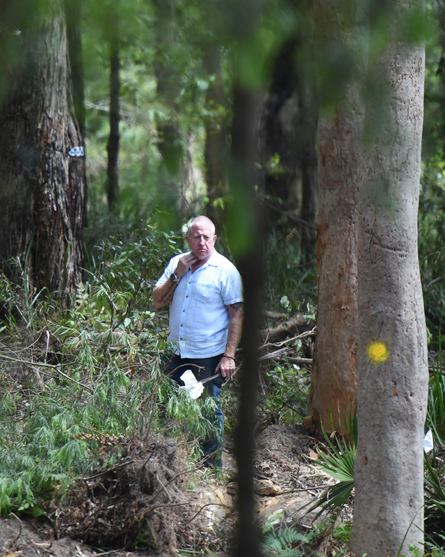 Father's mission: Mark Leveson wanders bushland as NSW Police search the site where it is believed Matthew Leveson is buried in the Royal National Park near Waterfall south of Sydney. Source: AAP