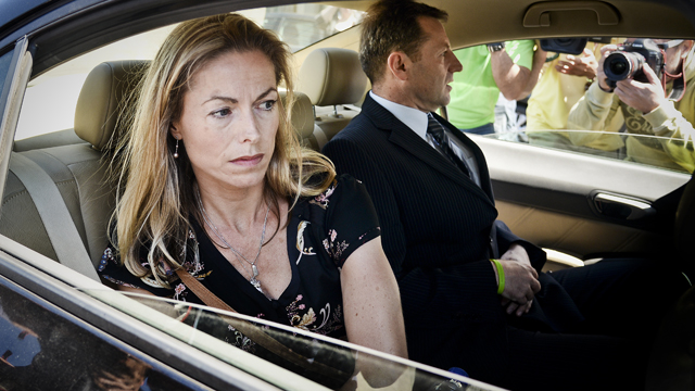 Kate McCann (L) and her husband Gerry McCann (R), parents of missing British youngster Madeleine McCann, leave the court house in Lisbon after delivering statements in their case against Portuguese police officer Goncalo Amaral on July 8, 2014.
