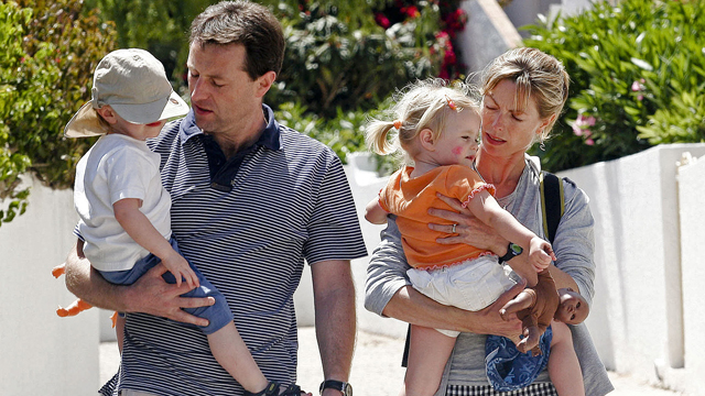 Gerry and Kate McCann, the parents of a missing three-year-old girl Madeleine McCann, walk with their twins outside their resort apartment 11 May 2007, in Praia da Luz, southern Portugal.