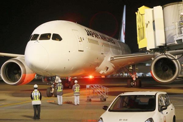 A JAL Dreamliner caught on fire after landing. (AAP)