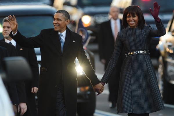 The Obamas celebrate after the president's swearing in. (Getty)