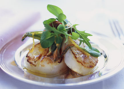 Seared scallops with shaved zucchini flowers