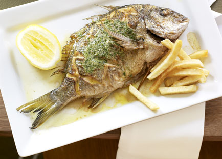 Whole sea bream with herb butter