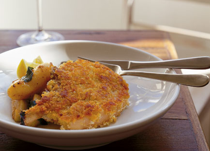 Crumbed pork cutlet with sautéed apples, potatoes and sage