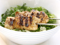 Chicken skewers with Greek lettuce salad