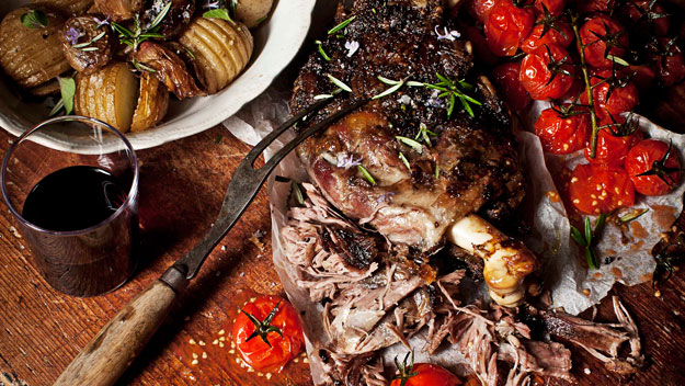 Slow-roasted greek lamb with tomatoes, onions and hasselback potatoes