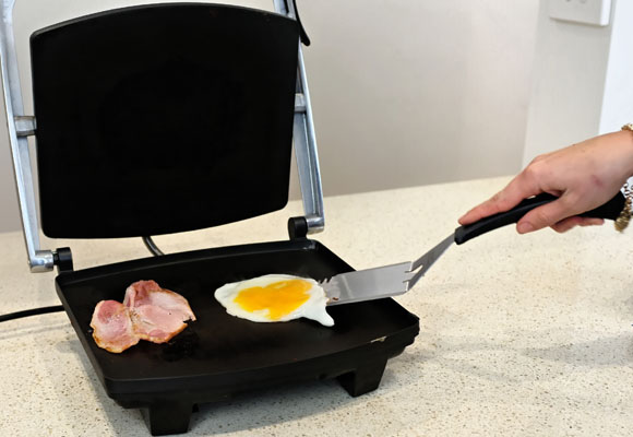 Bacon and eggs on the toasted sandwich maker