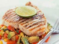 Char-grilled swordfish on warm avocado corn salad