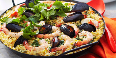 Seafood paella with rocket