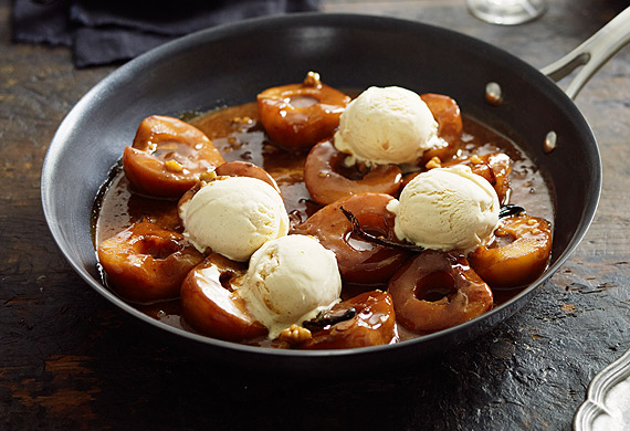 Roasted pear with salted caramel sauce, walnuts and vanilla ice-cream
