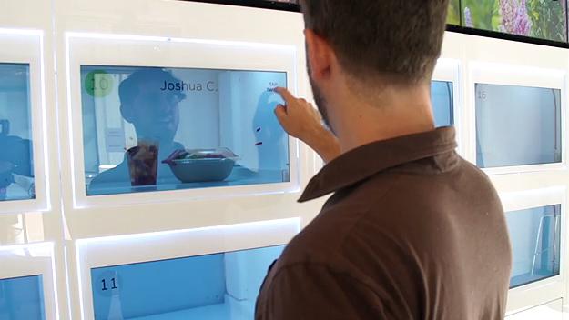 """Customer opening Eatsa cubby (<a href=""""http://techcrunch.com/2015/08/31/eatsa/"""">TechCrunch</a>)"""
