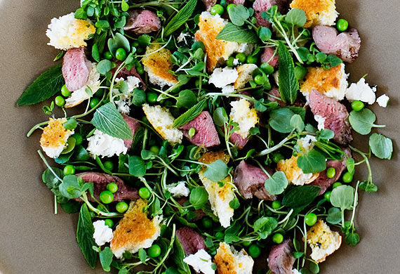 Warm grilled lamb, pea, mint and feta torn herb bread salad