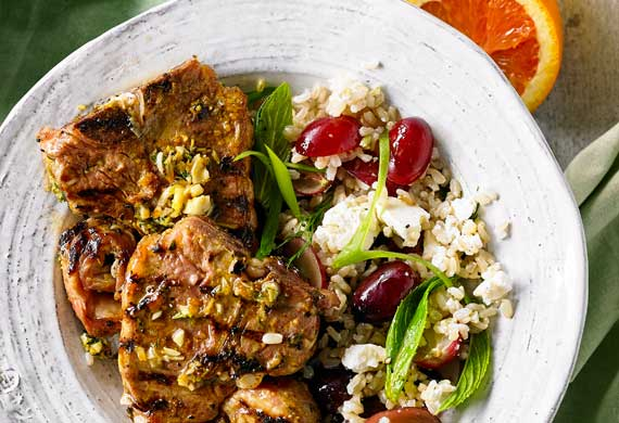 Orange and thyme lamb loin chops with brown rice, grape and feta salad
