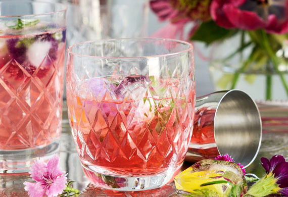 Rhubarb with raspberry and rosehip cocktail with flower power ice
