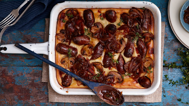 """Recipe:<a href=""""/recipes/isausage/8348791/yorkshire-sausage-bake"""" draggable=""""false"""">Yorkshire sausage bake</a>"""