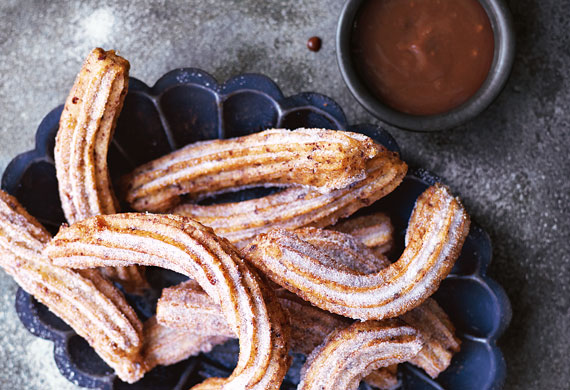 Orange-scented churros with caramel orange chocolate sauce