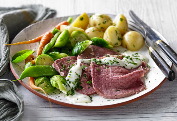 Corned beef with horseradish and parsley white sauce