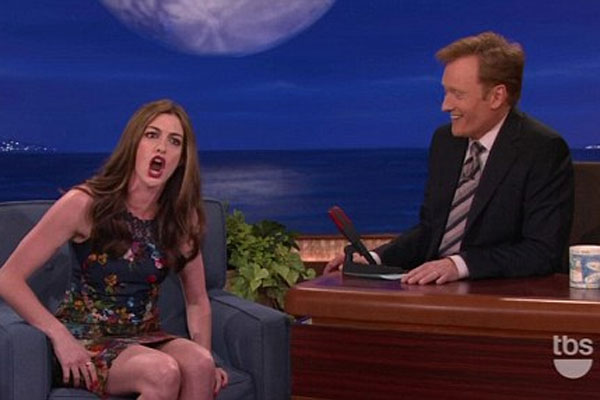 Anne Hathaway raps about the paparazzi on Conan O'Brien