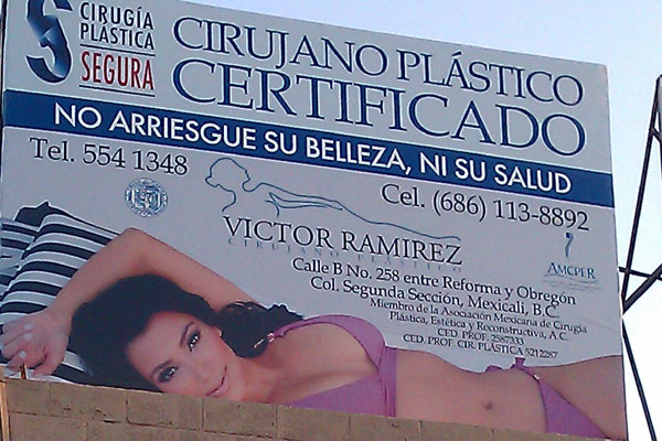 Kim Kardashian threatens legal action over use of image on cosmetic surgeon's billboard