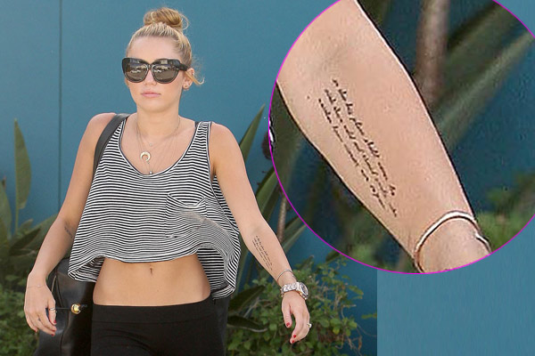 Miley Cyrus shows off new huge tattoo