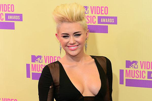 Miley Cyrus denies punching a guy during a nightclub brawl